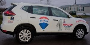 Anita Savoie with the REMAX car